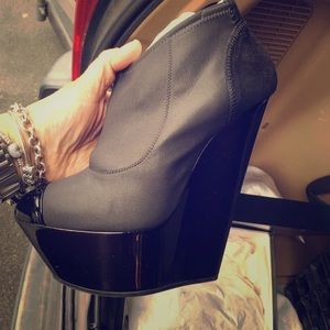 Brand new ankle booties in black in the box